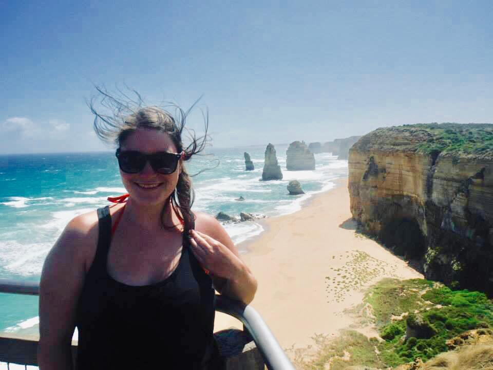 Photo of myself standing in front of the 12 apostles, showing how windy it is