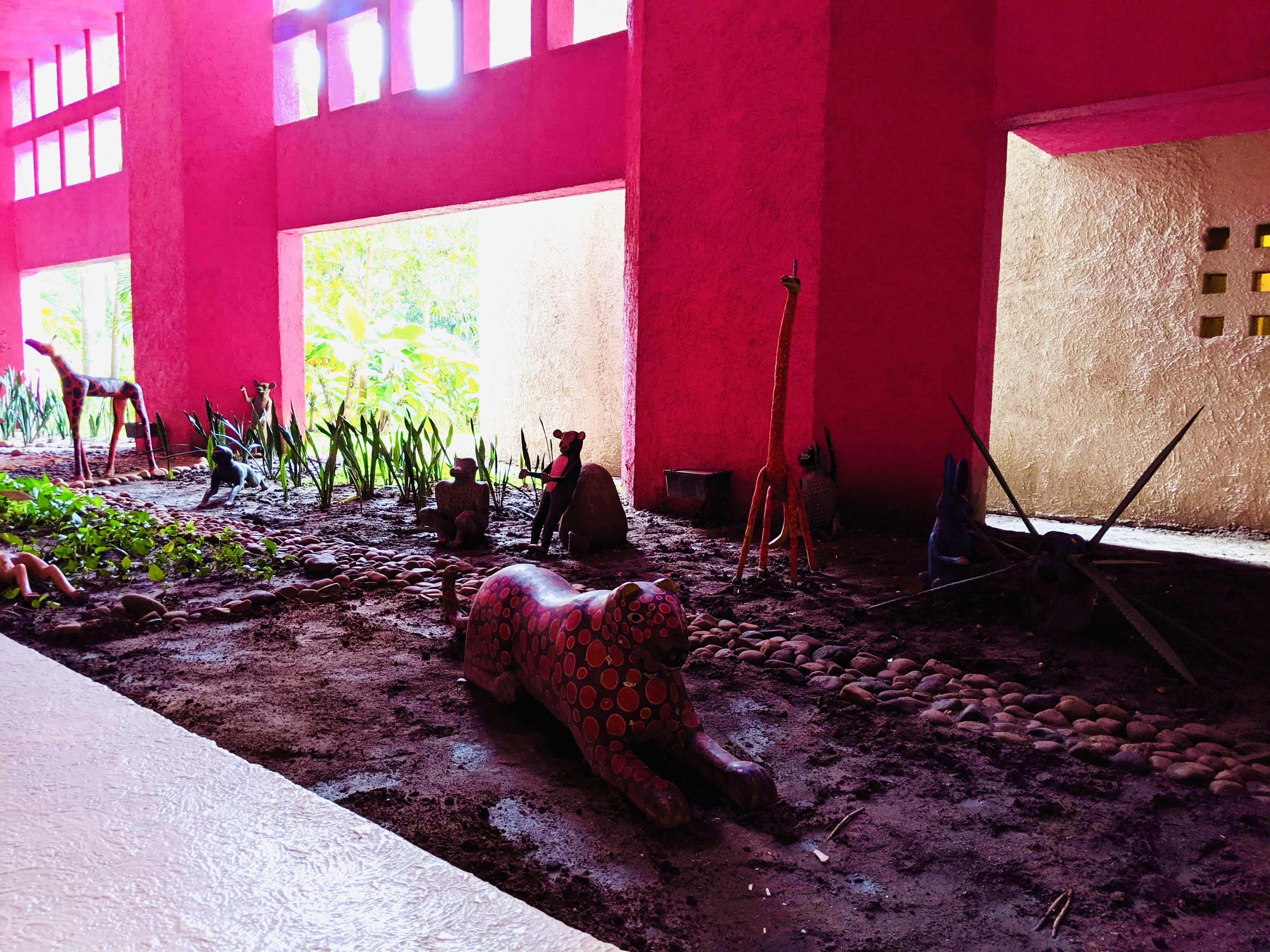 A sculpture of a big cat in the sand