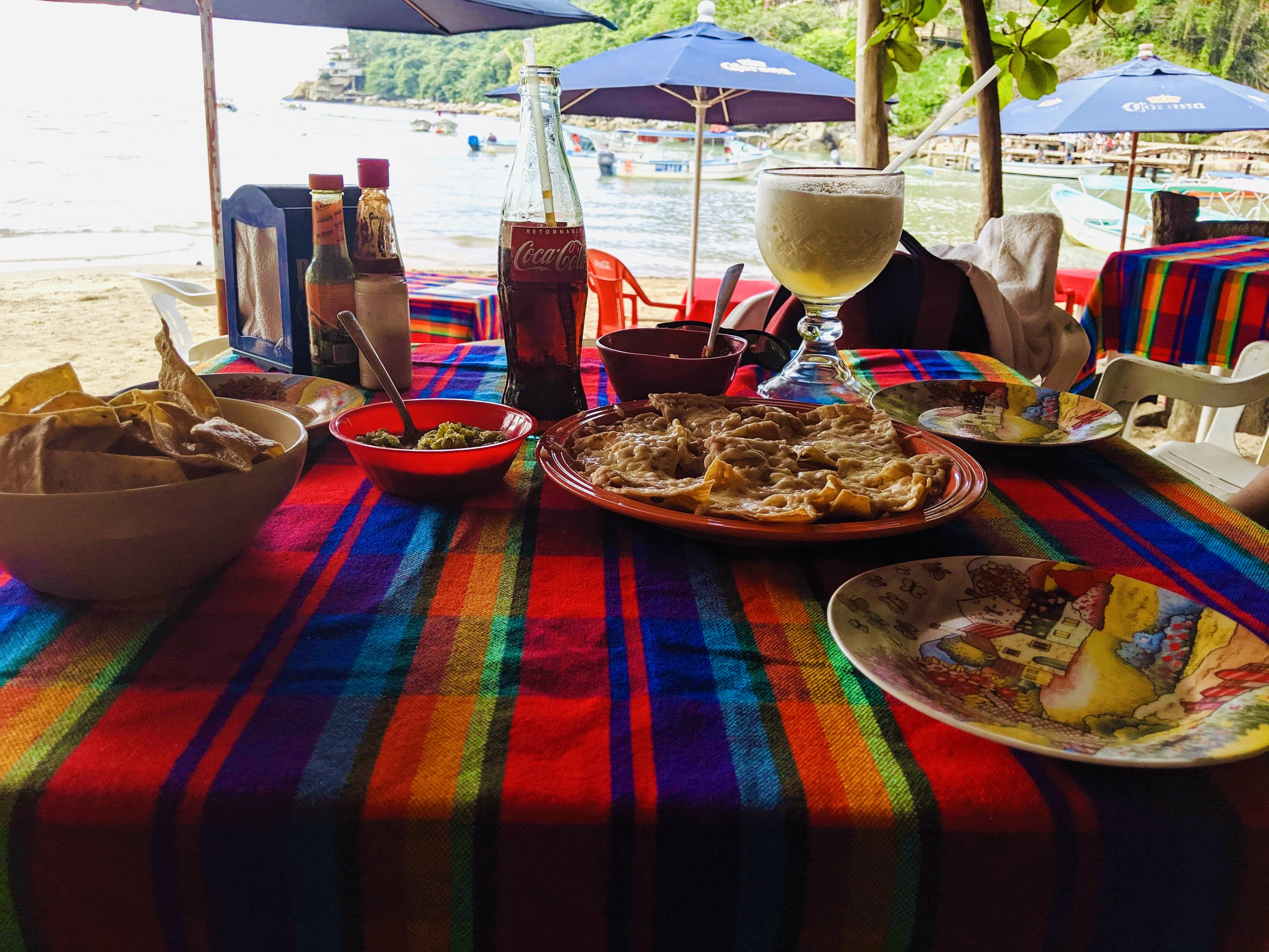 Our drinks and nachos at the beach in the fishing village