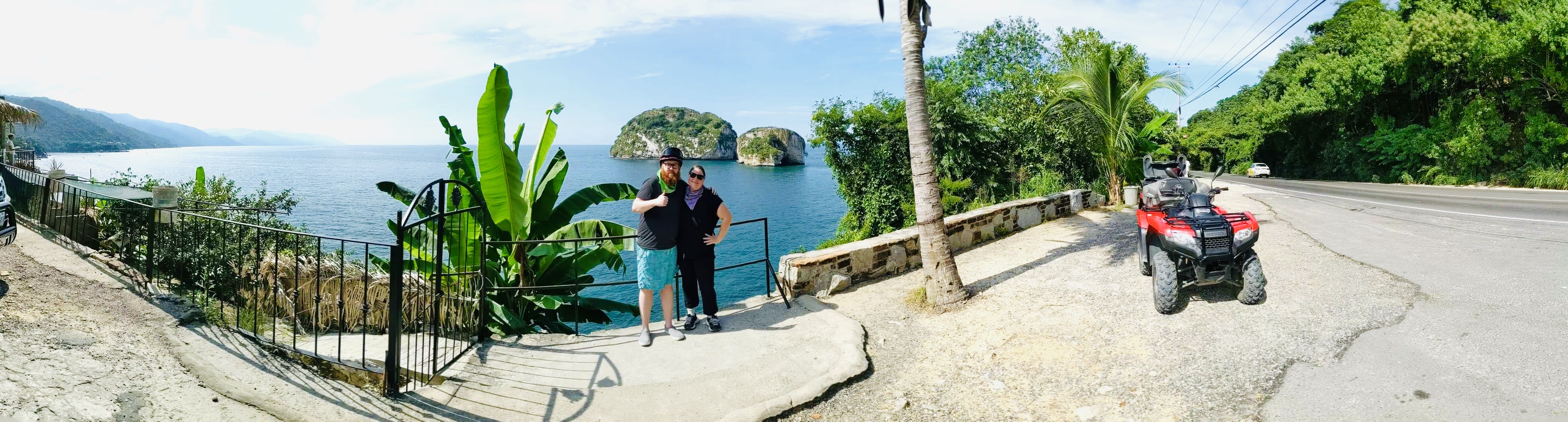 A panorama image of Scott and I in front of a look out of Los Arcos