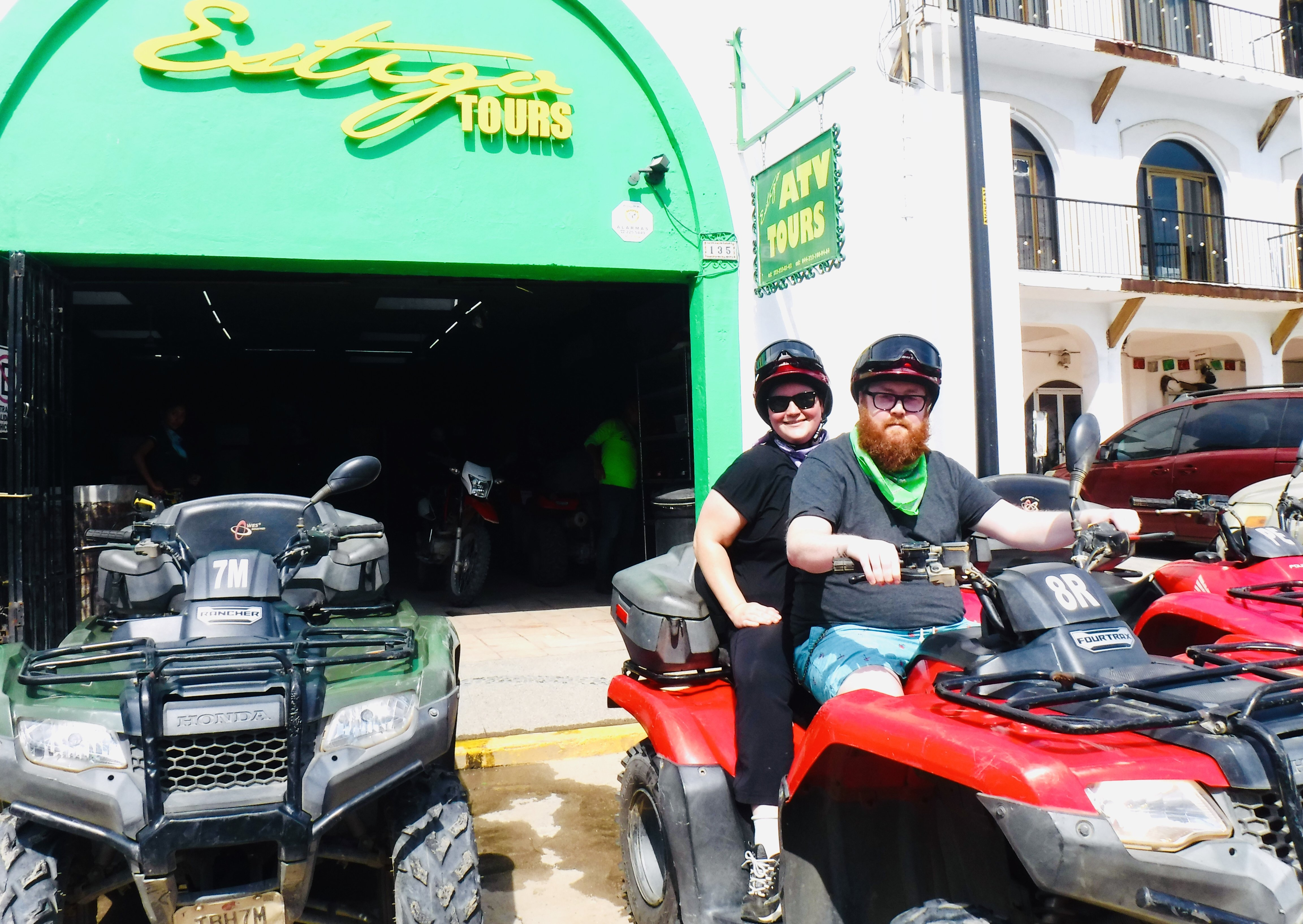 Scott and I sitting on an atv, in front of the Estigo Tours building