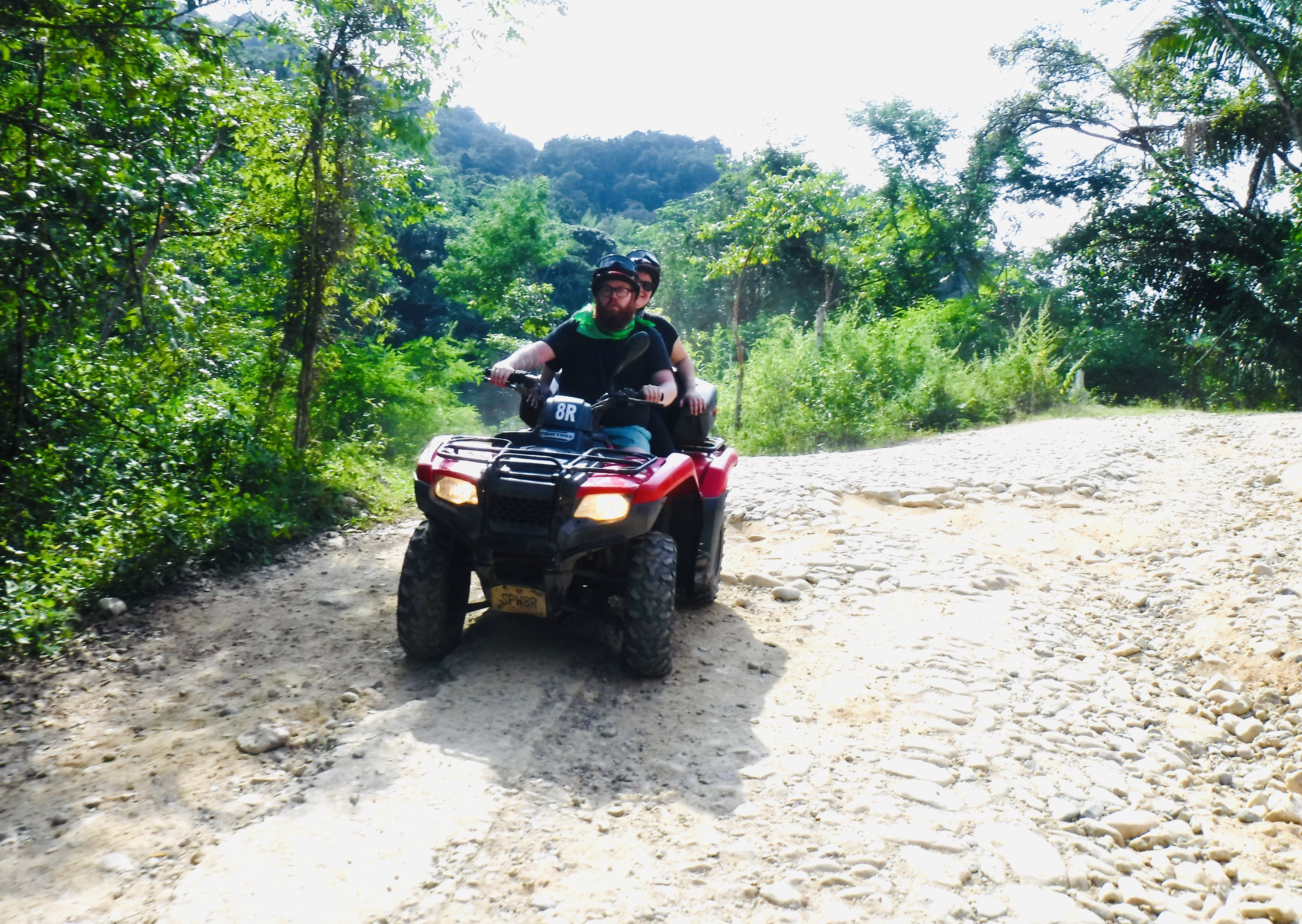 Scott and I on an atv, driving on the dirt road to the Predator movie set