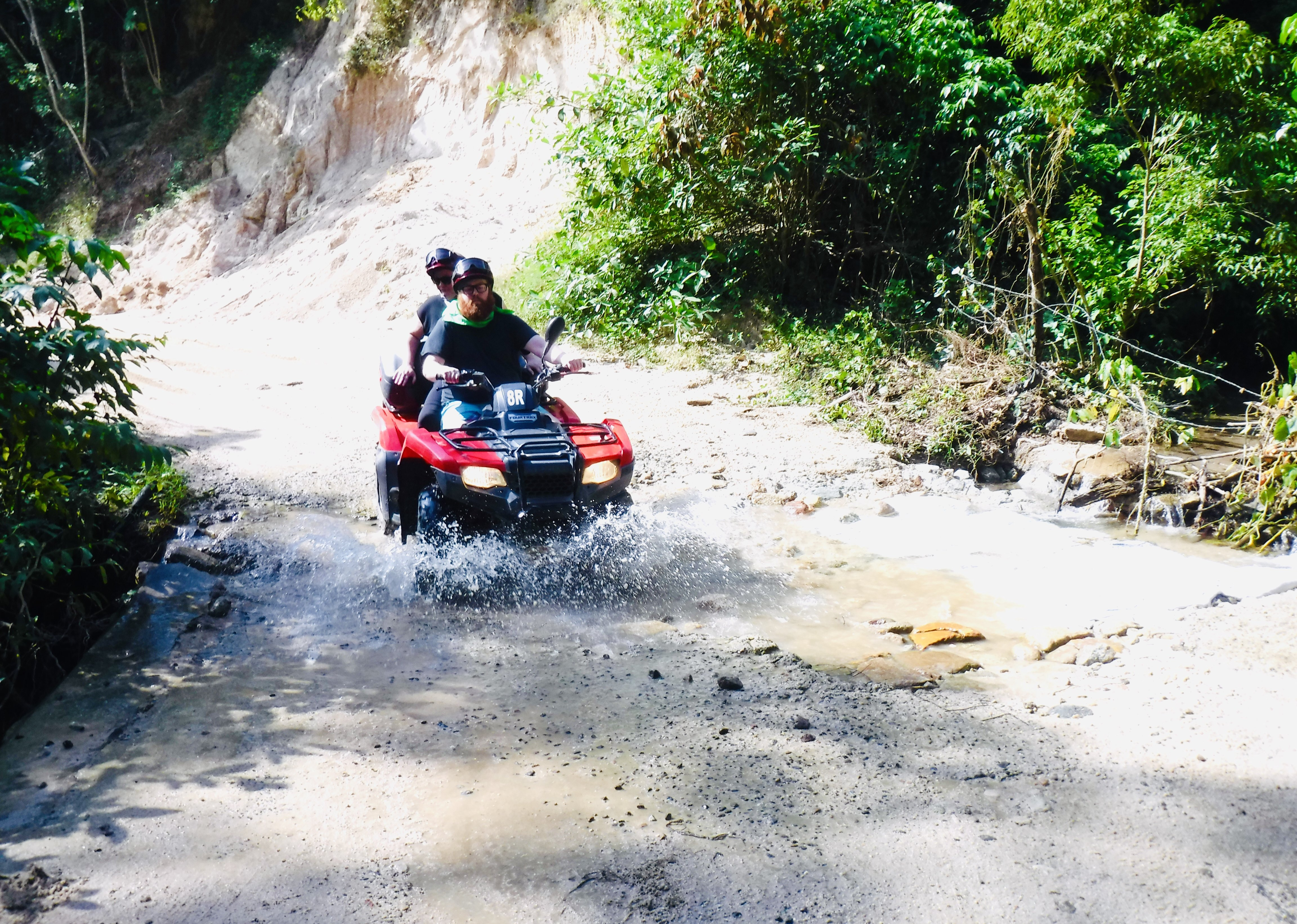 Scott and I on an atv, driving through water. Is Puerto Vallarta safe to travel?
