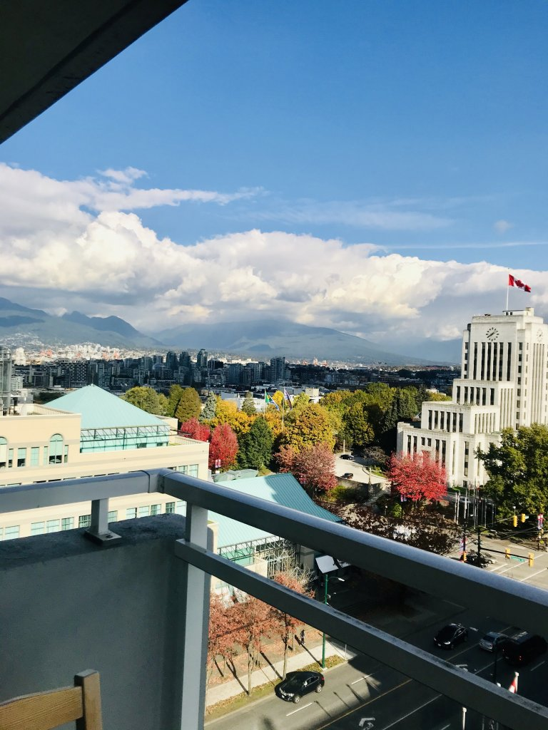 A view of the North Shore mountains and city of Vancouver, with plenty of fall foliage