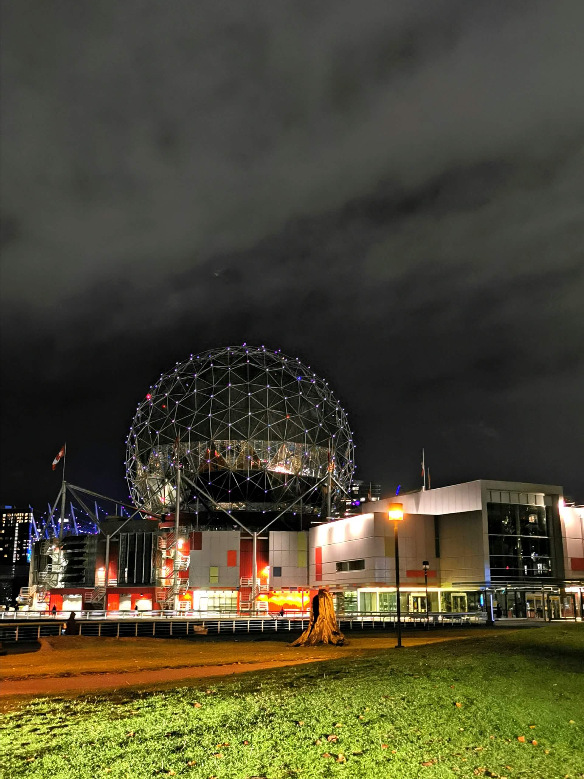 Science World lit up at night.