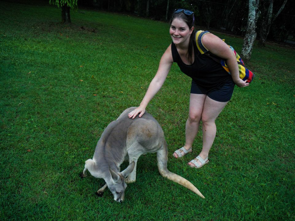 Brooklyn petting a kangaroo that is leaning down
